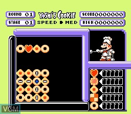 In-game screen of the game Yoshi's Cookie on Nintendo NES
