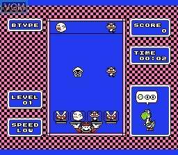 In-game screen of the game Yoshi on Nintendo NES